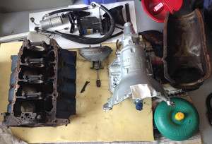 Transmission and torque converter for PROJECT BEDLAM, along with various incoming and outgoing parts.