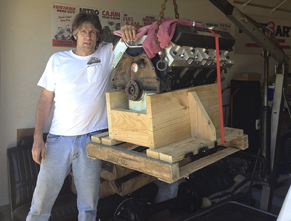 Posing with my engine, just as it was hoisted from my truck. No smile / Happy inside!